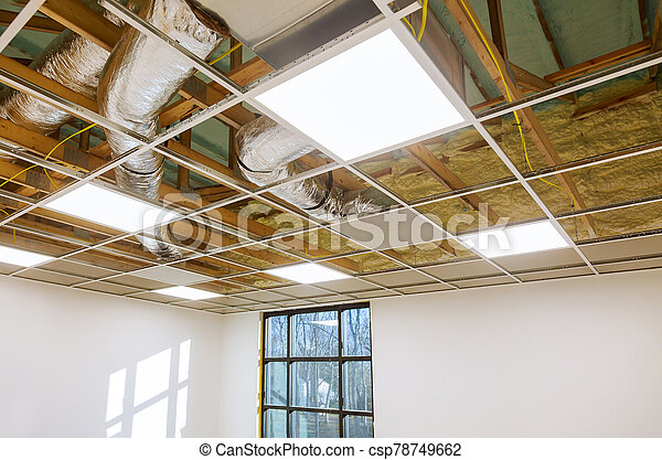 Air conditioning system attached to attic ceiling, foam plastic Insulation of a new home - csp78749662