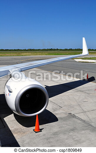 Air transportation: Jet engine and wing detail - csp1809849