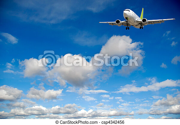 Air travel - Plane flying in blue sky with clouds - csp4342456