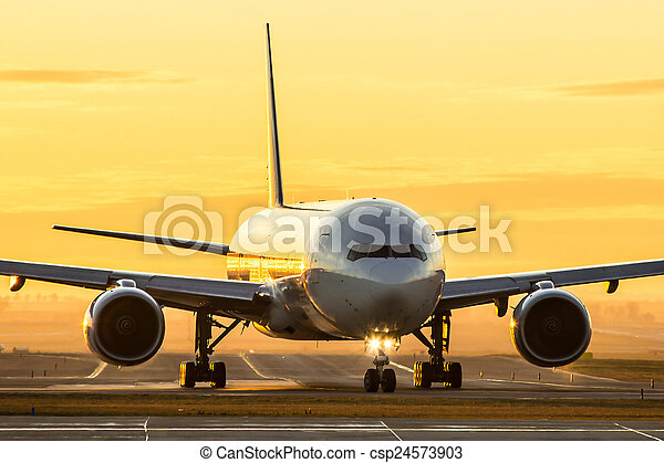 Aircraft at sunset - csp24573903