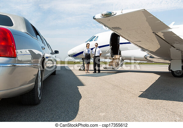 Airhostess And Pilot Standing Neat Limousine And Private Jet - csp17355612