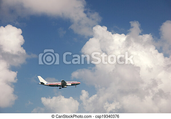 Airplane approaching the runway - csp19340376