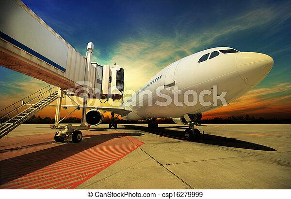Airplane at sunset - back lit - csp16279999
