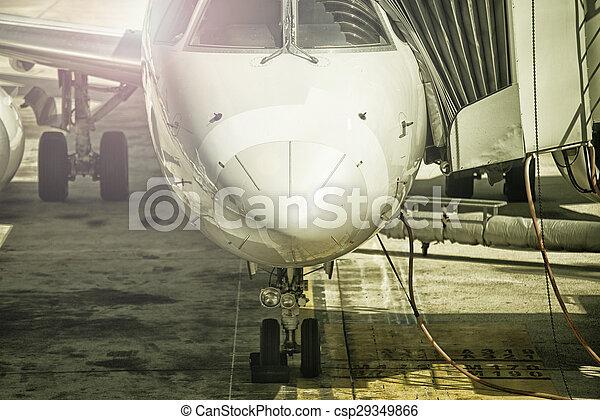 Airplane at sunset, close up - csp29349866