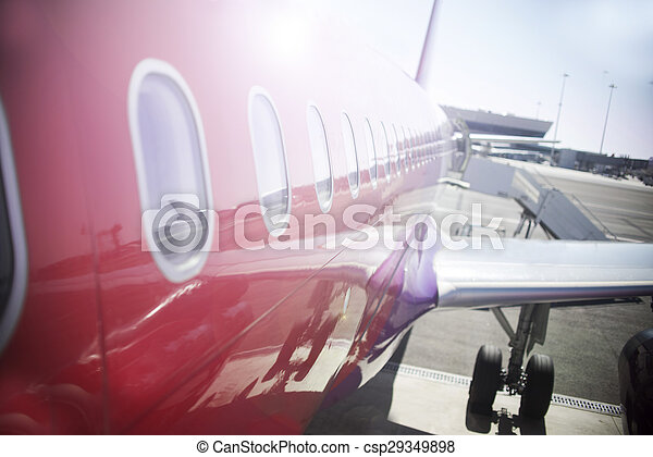 Airplane at sunset, close up - csp29349898