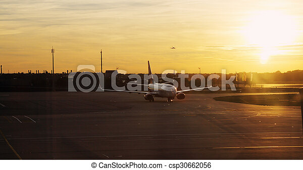 airplane at sunset - csp30662056