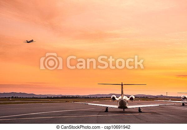 Airplane at sunset - csp10691942