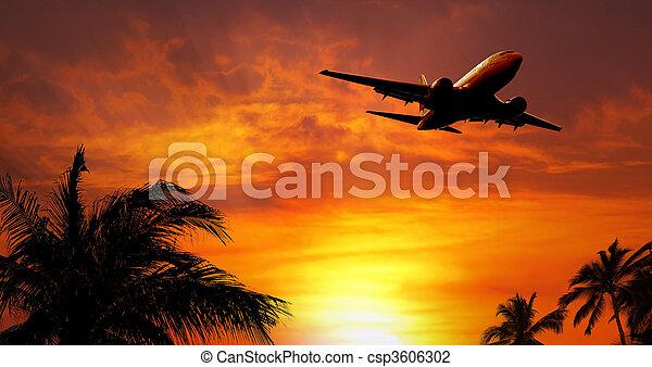 Airplane at sunset - csp3606302