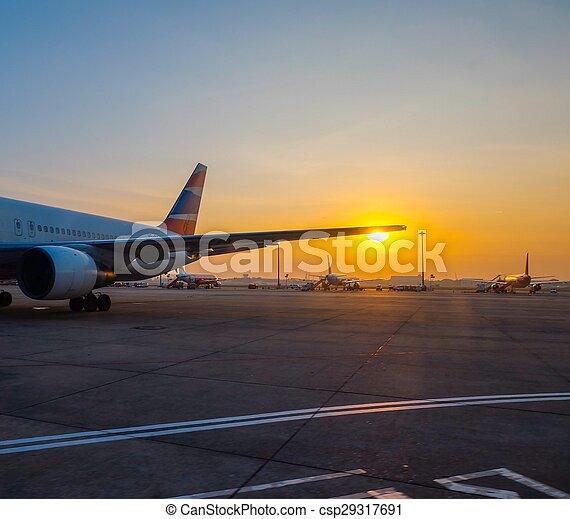 Airplane at sunset - csp29317691