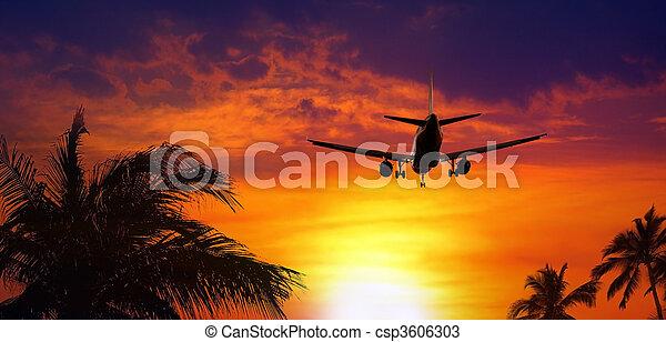 Airplane at sunset - csp3606303