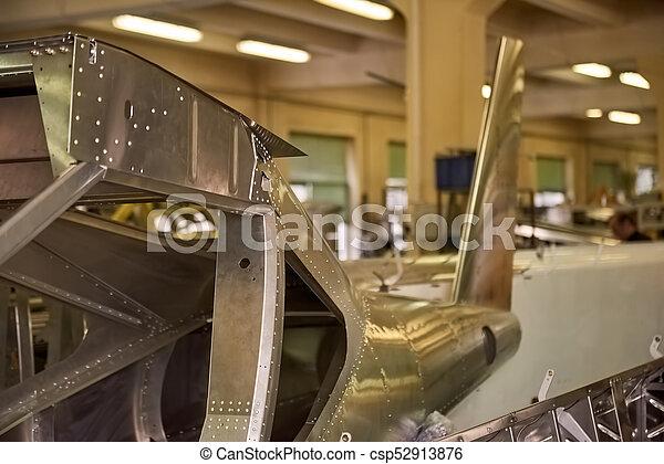 Airplane body part in workshop. - csp52913876