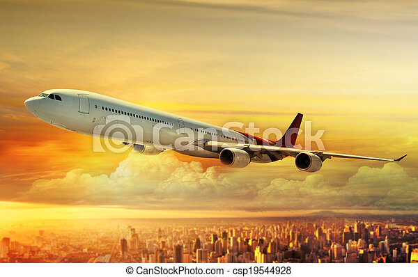 Airplane flying above city - csp19544928