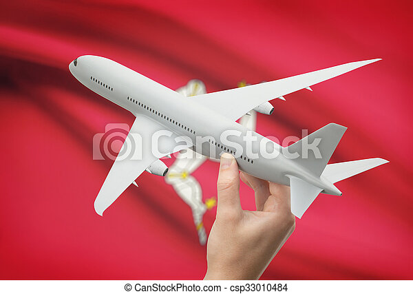 Airplane in hand with flag on background - Isle of Man - csp33010484