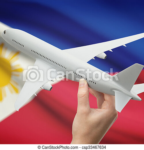 airplane in hand with flag on background philippines airplane in