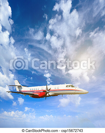 Airplane inflight in the sky - csp15672743