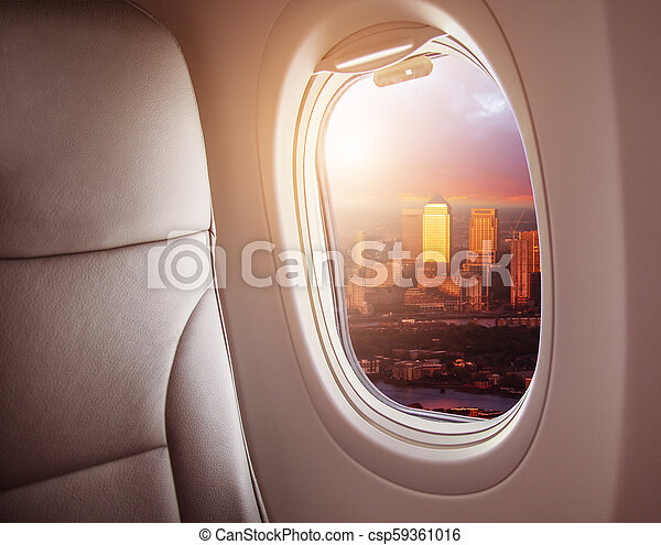 Airplane interior with window view of London city, Europe. - csp59361016