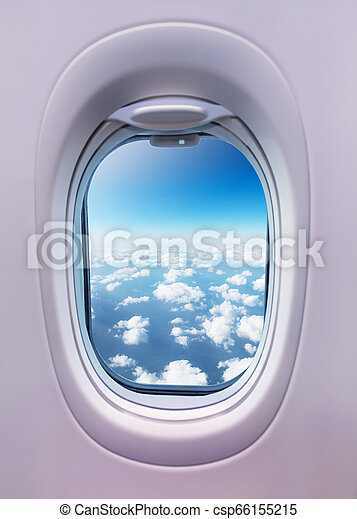 Airplane interior with window view of clouds. - csp66155215