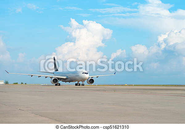 Airplane on runway strip in an airport - csp51621310
