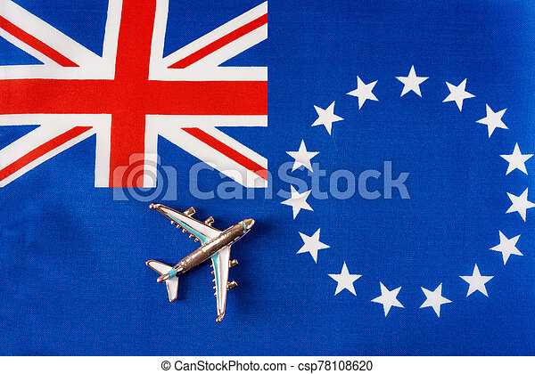 Airplane over the flag of the cook Islands travel concept. - csp78108620
