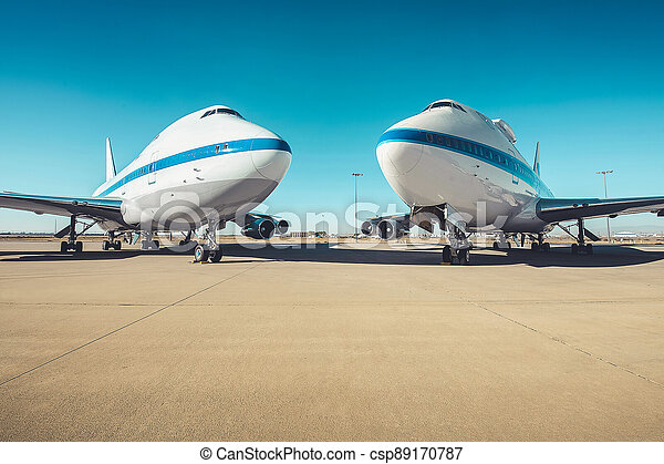 Airplane parking on an airport runway in sunny day . - csp89170787