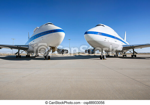 Airplane parking on an airport runway in sunny day . - csp88933056
