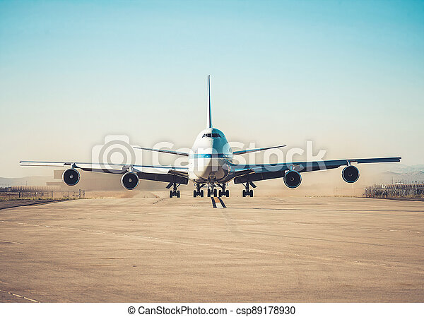 Airplane parking on an airport runway in sunny day . - csp89178930