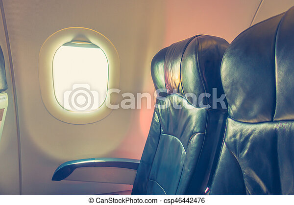 Airplane seats in the cabin . ( Filtered image processed vintage effect. ) - csp46442476