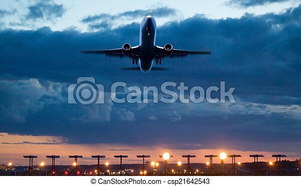 Airplane take of at dusk - csp21642543