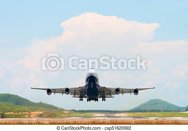 Airplane take off above airport runway - csp51620992