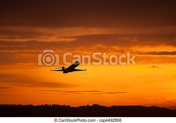 airplane takeoff in sunset - csp4492806