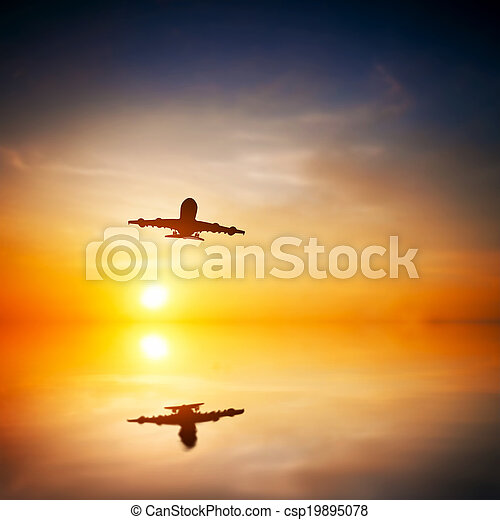 Airplane taking off at sunset. Silhouette of a big passenger or cargo aircraft, airline flying. Abstract water reflection. Transportation - csp19895078