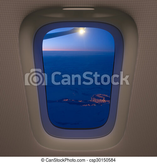 Airplane Window And Winter Landscape Lone City In Snow Fields