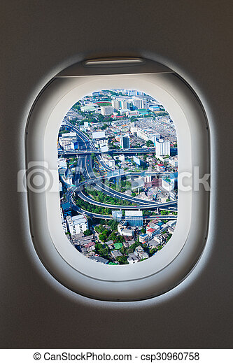 Airplane window from interior of aircraft with high way view. - csp30960758