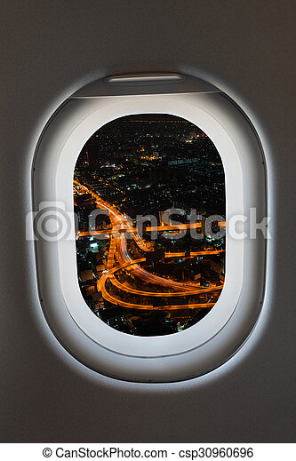 Airplane window from interior of aircraft with high way view.  - csp30960696