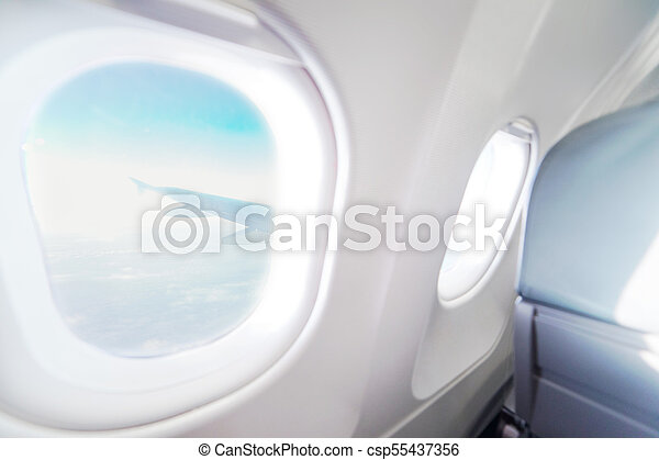 Astonishing Airplane Window View Inside An Aircraft Window Plane Vacation Destinations Concept Light Blue Seats And White Interior With View On Sky And Wing Of Cjindustries Chair Design For Home Cjindustriesco