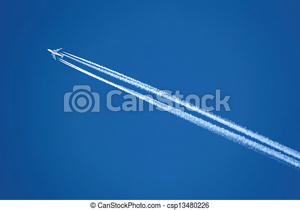 Airplane with contrail - csp13480226