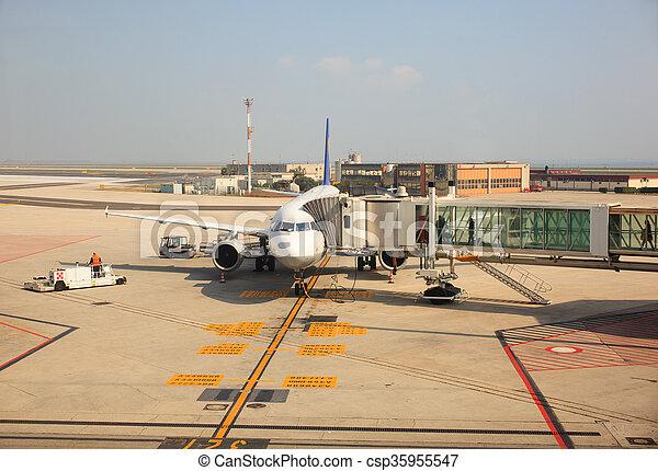 Airplane With Passenger Stairs   Csp35955547