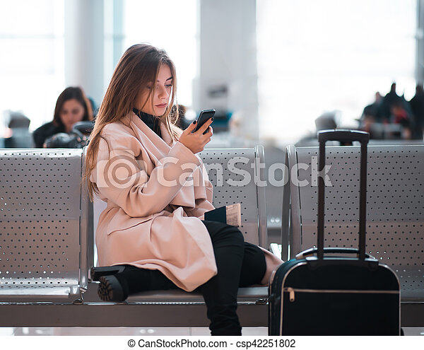 Airport business woman waiting in terminal. - csp42251802