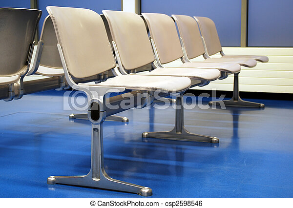 airport lounge with grey seats on blue floor - csp2598546