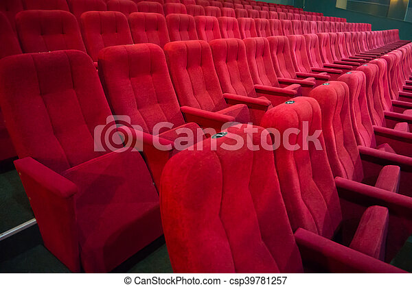 Aisle with rows of red seats - csp39781257