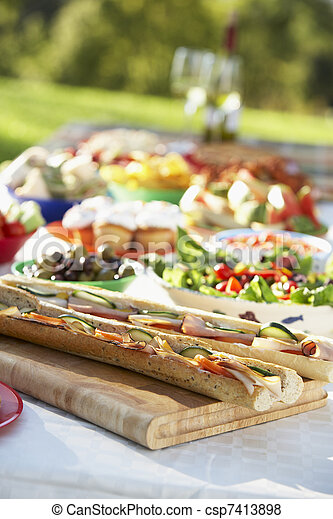 Al Fresco Dining, With Food Laid Out On Table - csp7413898