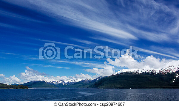 Alaskan Sky Clouds Left to right - csp20974687