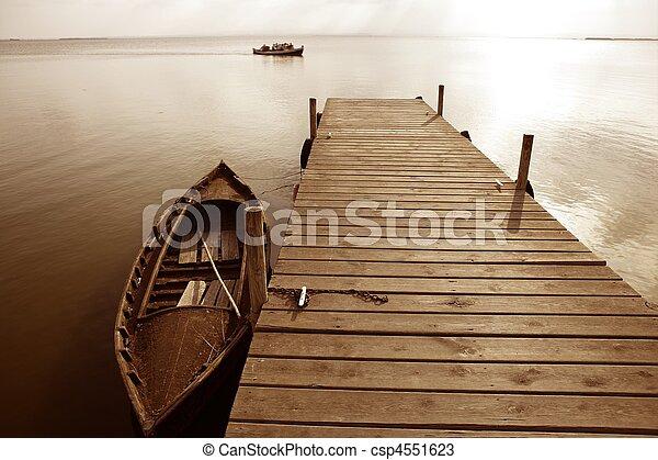 Albufera lake wetlands pier in Valencia Spain - csp4551623
