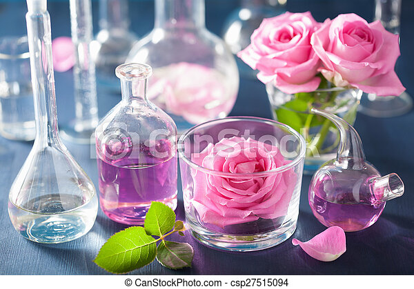 alchemy and aromatherapy set with rose flowers and chemical flasks - csp27515094