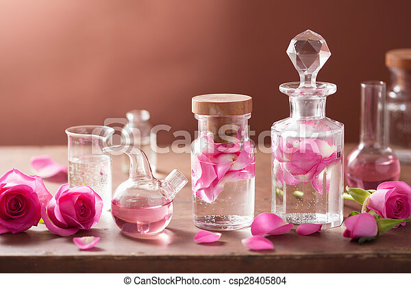 alchemy and aromatherapy set with rose flowers and flasks - csp28405804