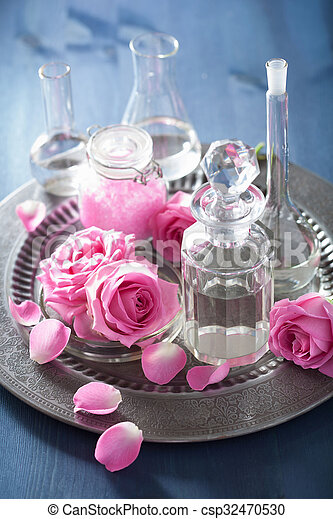 alchemy and aromatherapy with rose flowers and chemical flasks - csp32470530