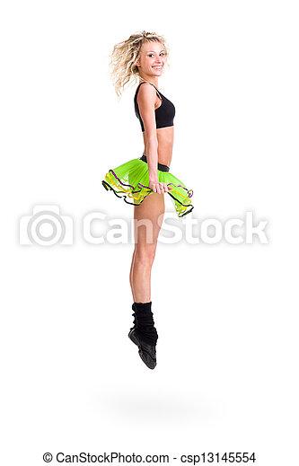 Mujer en forma saltando de alegría - csp13145554