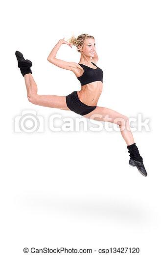 Mujer en forma saltando de alegría - csp13427120