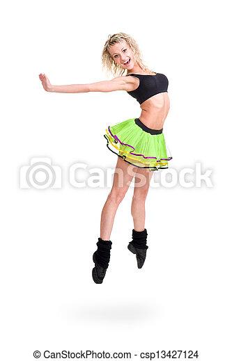Mujer en forma saltando de alegría - csp13427124
