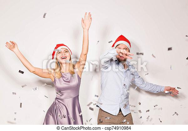 alegre, fiesta, confeti, fondo., regado, joven, nuevo, concepto, -, gente, navidad, blanco, año - csp74910984
